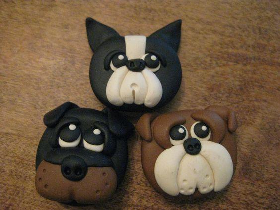 Голова собаки из полимерной глины. Здесь и ротвейлер, и два бульдожка,  один простой бульдог, второй французский. Правильно я назвала породы?